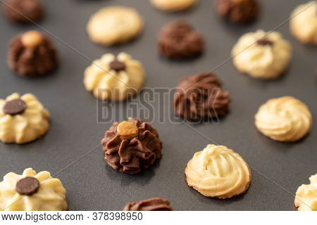 Homemade Assorted Chocolate Bite Size Butter Cookies On Baking Tray
