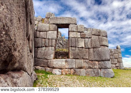 Stone Door. View Of Sacsayhuaman, Inca Ruins In Cusco Or Cuzco Town, Peru