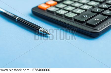 Close Up Of Calculator And Pen On Blue Background For Mockup Design Modern Lifestyle Stationary Conc