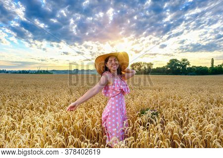 Smiling Cheerful Woman In Wheat Field Turn Around With Outstretched Arms At Dawn