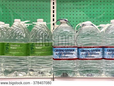 Alameda, Ca - June 29, 2020: Grocery Store Shelf With Large Jugs Of Water. Crystal Geyser And Generi