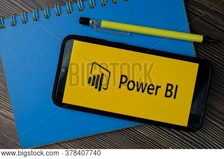 Microsoft Power Bi Dev App On Smartphone Screen. Power Bi Is A Freeware Web Browser Developed By Mic