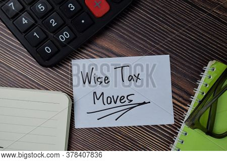 Wise Tax Moves Text Write On Sticky Notes Isolated On Office Desk.