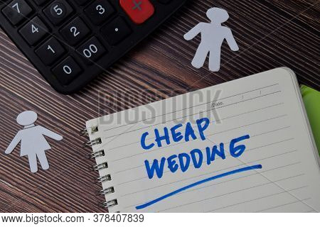 Cheap Wedding Text Write On A Book Isolated Wooden Table.