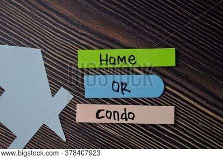 Home Or Condo Text Write On Sticky Notes Isolated On Office Desk.