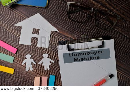 Homebuyer Mistakes Text Write On Paperwork Isolated On Office Desk.