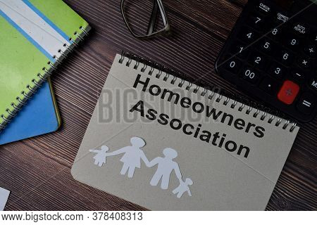 Homeowners Association Text Write On A Book Isolated Wooden Table.