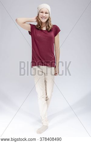 Full Length Portrait Of Caucasian Teenager Girl With Teeth Brackets. Posing With Backpack Indoors.