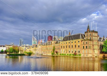 Binnenhof Palace Of Parliament Inthe Hague In The Netherlands At Daytime. Against Modern Skyscrapers