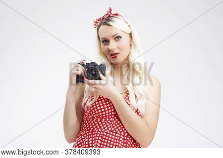 Pin-up Girl Concepts. Caucasian Blond Girl Posing In Pin-up Style And Holding Retro Film Camera In H