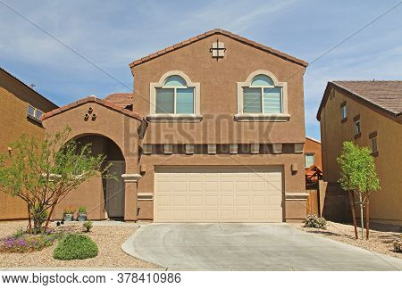 New Two-story, Brown And Beige Stucco Home In Tucson, Arizona, Usa With Beautiful Blue Sky And Lands