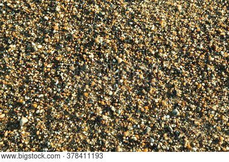 Texture of osean beach pebble stones.
