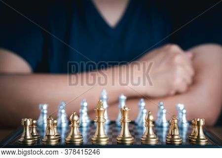 Front View Of Chess Game On Chessboard With Blur Background. Business Game Competitive Strategy. Con