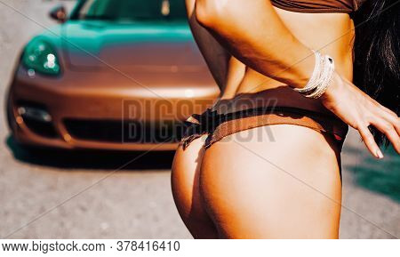 Slim Girl With Lovely Round Butt. Beautiful Womans Butt. Rich Concept. Sexy Female Booty On Luxury C