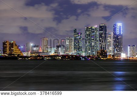 Miami Business District, Lights And Reflections Of The City. Miami, Florida, Usa Skyline On Biscayne