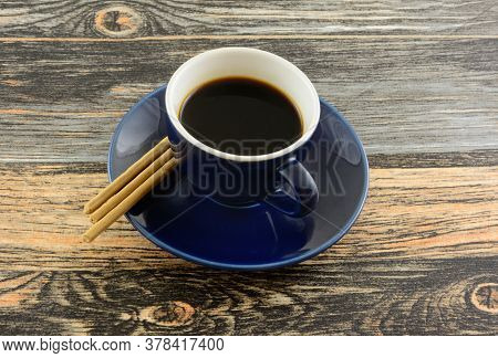 Demi-tasse Cup Of Coffee With Kona Coffee Flavored Biscuit Snacks On Table