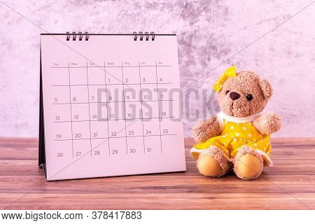 Teddy Bear With Calendar On Table Wooden. Valentine's Day Celebration