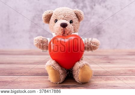 Teddy Bear With Heart On Table Wooden. Valentine's Day Celebration