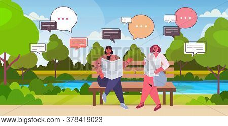 Girls Reading Newspaper Discussing Daily News During Meeting In Park Chat Bubble Communication Conce