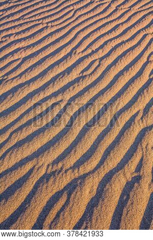 Mesquite Flat Sand Dunes - dunes in Death Valley, USA. Magical desert morning. The sand lies in light waves. The concept of active, extreme and photo tourism