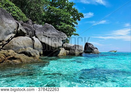 Amazing Andaman Sea. Transparent Aquamarine Water, Azure Sky. There Are Huge Picturesque Boulders An