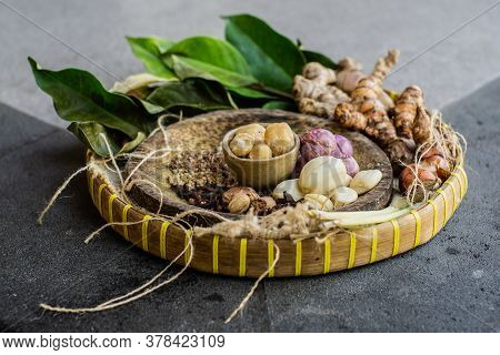 Native Spices Of Indonesia. Spices Such As Nutmeg Or Mace, Cloves, Pandanus Leaves, Palm Trees, And