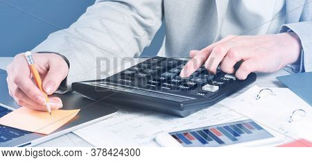 Finance And Business Concept. Female Small Business. Hand Pointing At Statistics Chart. Calculator O