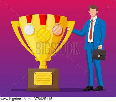Successful Businessman Near Big Gold Trophy Cup With Medals, Celebrates His Victory. Business Succes