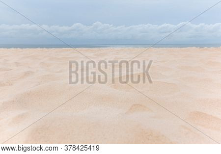 Beautiful White Sandy Tropical Beach With Ocean And White Cloud.