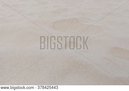Sand On The Beach As Background Texture Close Up.
