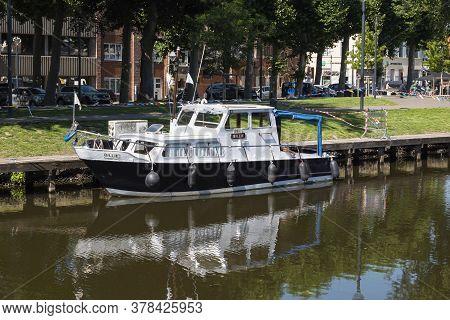 Lokeren, Belgium, July 13, 2020, Black And White Pleasure Boat Moored On The River Durme