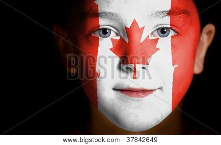 Portrait of a child with a painted Canadian flag