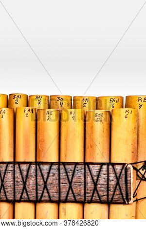 Andean Wind Instrument Pan Flute Reeds On A White Background