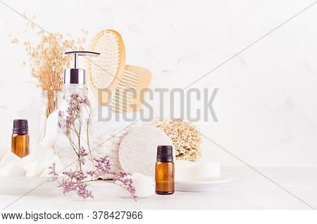White Bathroom Interior With Natural Bamboo Accessories And Beauty Products - Essential Oil In Amber