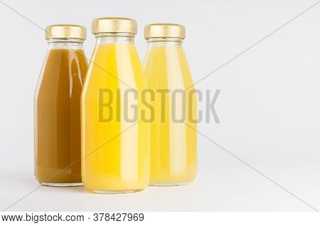 Orange, Yellow Fruit Juices Collection Mock Up In Glass Bottles With Cap, Closeup,  Group On White B
