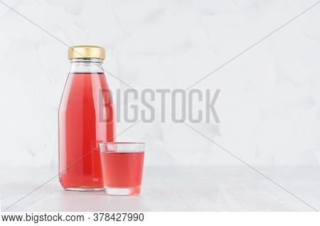 Fresh Pink Fruit Juice In Glass Bottle Mock Up With Glass On Wood Table In White Interior, Template