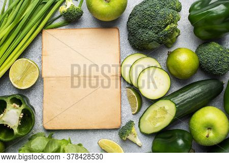 Frame Fresh Green Vegetables And Herbs On A Grey Concrete Background. Copy Space.