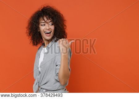 Side View Of Cheerful Young African American Woman Girl In Gray Casual Clothes Isolated On Orange Ba