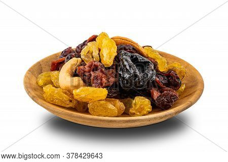 Various Dried Fruit In A Wooden Plate On White Background With Clipping Path.