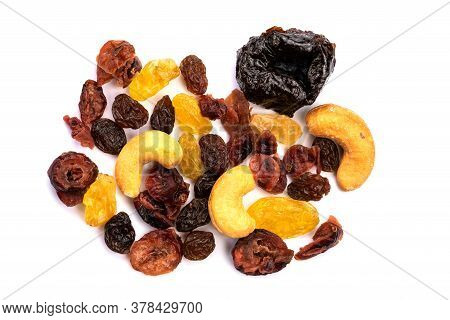 Top View Of Different Kinds Of Mixed Dried Fruit On White Background.