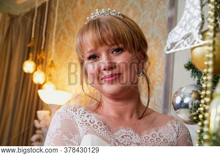 Bride In A Beautiful White Dress In A Nice Room Before Christmas