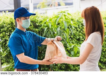 Asian Delivery Express Courier Young Man Giving Paper Bags Fast Food To Woman Customer Receiving Bot