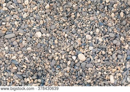 Small Pebble Stones On The Beach. Abstract Background