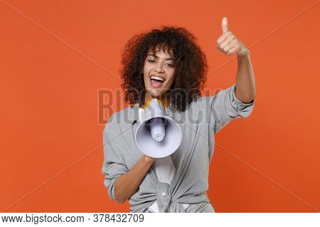 Cheerful Young African American Woman Girl In Gray Casual Clothes Isolated On Orange Background Stud