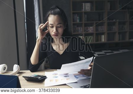 Budget And Tax Planning Concept, Accountant Is Calculating Company Annual Tax. Calendar 2019 And Per