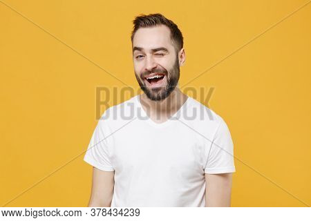 Cheerful Funny Young Bearded Man Guy 20s In White Casual T-shirt Posing Isolated On Yellow Wall Back
