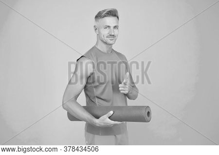 Are You With Me. Sportsman Point Finger Blue Background. Sports Coach Hold Yoga Mat. Physical Traini