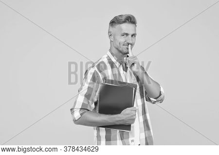 Back To School. Man Tutor Hold Exercise Book For Lesson. University Student On Yellow Background. Ch
