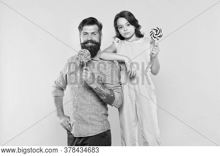 When Children Seem Hard To Please. Daughter And Father Eat Sweet Candy. Bearded Man And Cute Sweet B