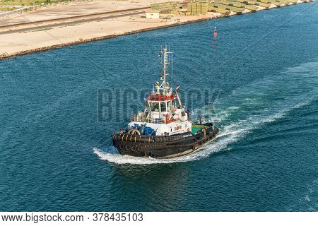 El Qantara, Egypt - November 14, 2019: Tugboat Accompanies The Ships. Ships Passing Through The Suez